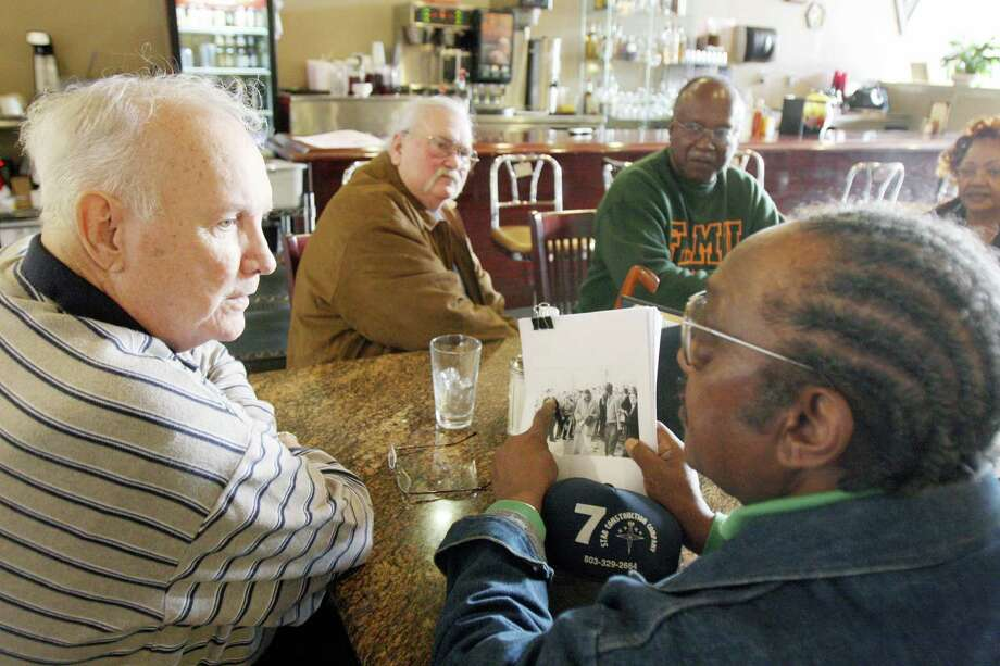 In 2009, Elwin Wilson, left, who pulled some of the Friendship 9 from their stools at a Rock Hill, S.C., lunch counter in 1961, meets with member Willie McCleod, right. Nine men will have their trespassing convictions erased. Photo: Andy Burris, MBO / The Herald