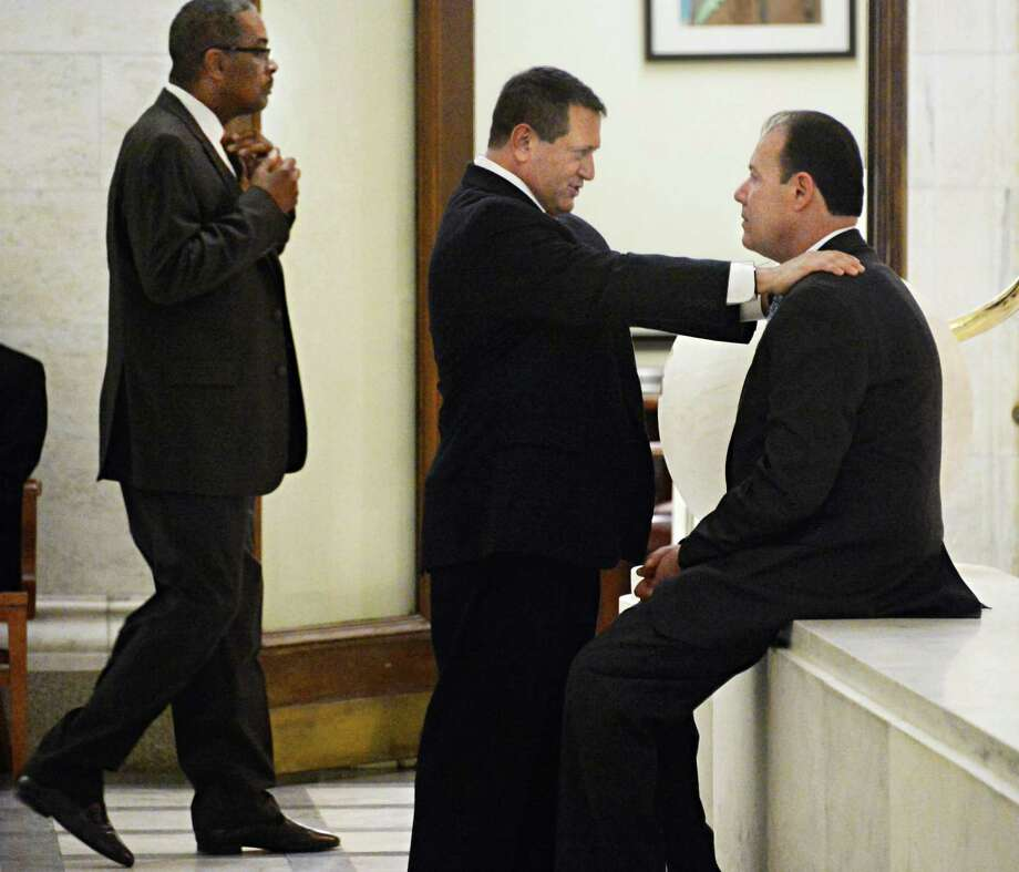 NYS Assembly Majority Leader Joseph Morelle, center, speaks with an unidentified man in a hallway outside the Assembly Chambers Tuesday Jan. 27, 2015. At left is NYS Assembly's sergeant-at-arms Wayne Jackson.  (John Carl D'Annibale / Times Union) Photo: John Carl D'Annibale
