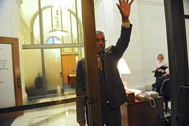Sergeant-at-Arms Wayne Jackson waves to someone in the hallway while Assembly members decide on the fate of Speaker Sheldon Silver at the Capitol on Monday, Jan. 26, 2015 in Albany, N.Y. (Lori Van Buren / Times Union) Photo: Lori Van Buren