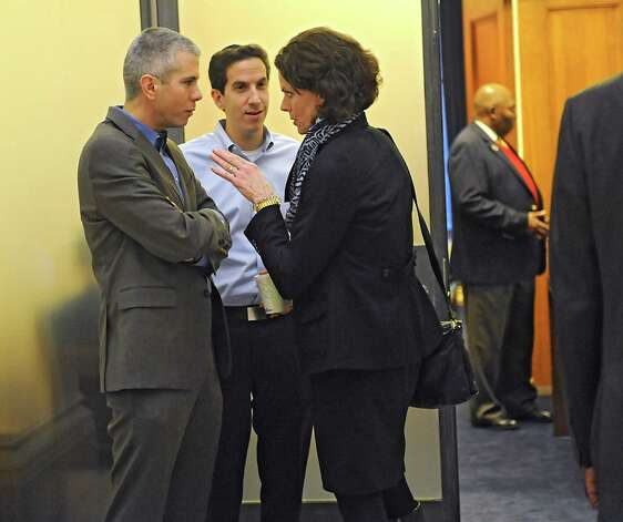 Assembly member Patricia Fahy talks to two men as Assembly members meet to decide on the fate of Speaker Sheldon Silver at the Capitol on Monday, Jan. 26, 2015 in Albany, N.Y. (Lori Van Buren / Times Union) Photo: Lori Van Buren