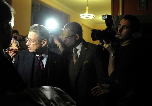 Sheldon Silver, left, leaves the Capitol building following a day of NYS Assembly debate on the Speaker future on Tuesday Jan. 27, 2015 in Albany, N.Y. (Michael P. Farrell/Times Union) Photo: Michael P. Farrell