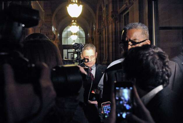 Sheldon Silver,center, leaves the Capitol building following a day of NYS Assembly debate on the Speaker's future on Tuesday Jan. 27, 2015 in Albany, N.Y. (Michael P. Farrell/Times Union) Photo: Michael P. Farrell