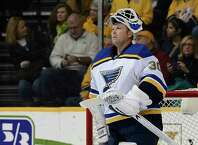 FILE - In this Dec. 4, 2014, file photo, St. Louis Blues goalie Martin Brodeur looks up at the scoreboard during a timeout in the first period of an NHL hockey game against the Nashville Predators in Nashville, Tenn. Brodeur, one of the greatest goaltenders in NHL history, is retiring. He starred for years with New Jersey Devils and is now with St. Louis. (AP Photo/Mark Zaleski, File) ORG XMIT: NY157