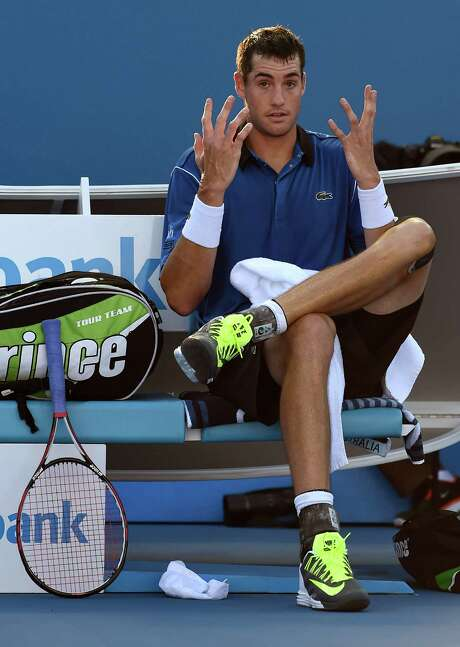 John Isner of the U.S. gestures during a break as he plays Gilles Muller of Luxembourg during their third round match at the Australian Open tennis championship in Melbourne, Australia, Saturday, Jan. 24, 2015. (AP Photo/Andy Brownbill) Photo: Andy Brownbill, STF / AP
