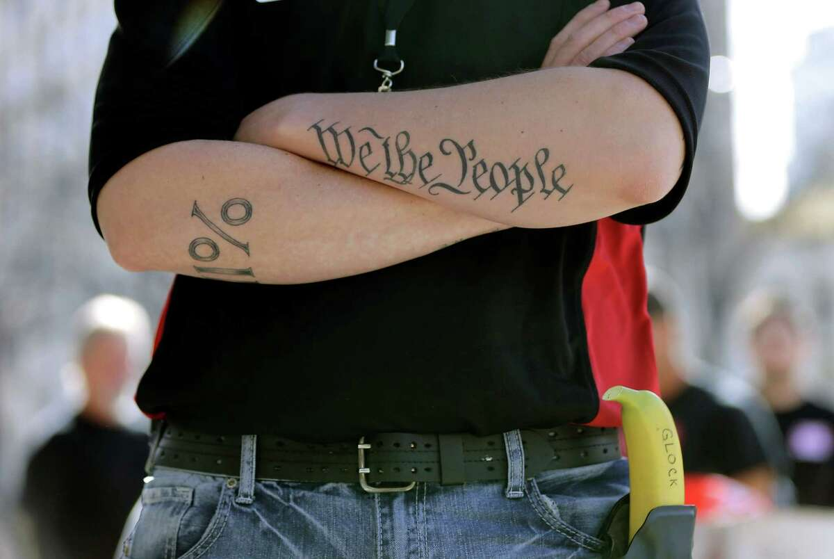 Conley Hennigan sports a holstered banana during a rally in support of open carry gun laws at the Capitol this week.