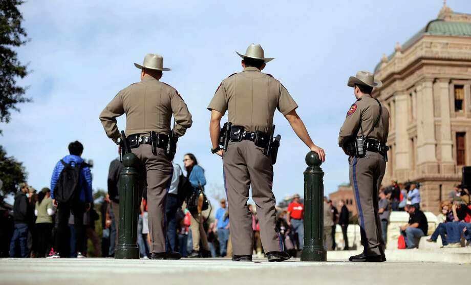 Texas state troopers watch over the rally. Bills to allow open carry have been filed. Photo: Eric Gay /Associated Press / AP