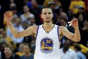 Golden State Warriors' Stephen Curry reacts to an official's call late in Chicago Bulls' 113-111 win in overtime during NBA game at Oracle Arena in Oakland, Calif., on Tuesday, January 27, 2015.