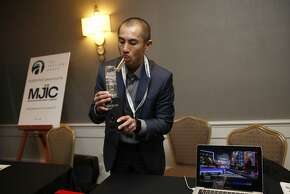 Vapexhale CEO Seibo Shen, who used to be in tech, gives a product demonstration at the cannabis investment conference.