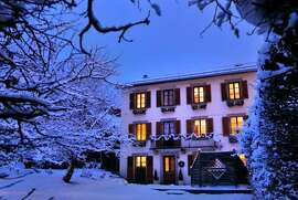 CHALET CACHE IN CHAMONIX, FRANCE:  On the border of Switzerland, Chamonix is a snow-white paradise for skiers in the winter and this chalet is near the slopes.