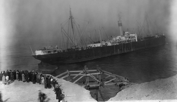 A dramatic photo of the wreck of the freighter SS Ohioan at Point Lobos. The cargo ship was built in 1914 and sailed all over the world until the foggy morning of Oct. 8, 1936 when the Ohioan ran aground near Seal Rock. The ship became a major attraction for gawkers, like those seem here. The Coast Guard was called in to evacuate the crew.
