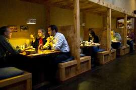 Each table at Ippuku is separated by partitions.