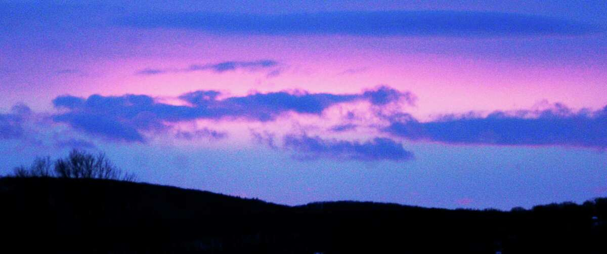 Late on Tuesday afternoon, Jan. 27, 2015, the western sky over Candlewood Lake presents a beautiful, albeit subdued sunset in the wake of a two-day snowstorm that clearly had fallen well shy of expections in the Greater New Milford area.