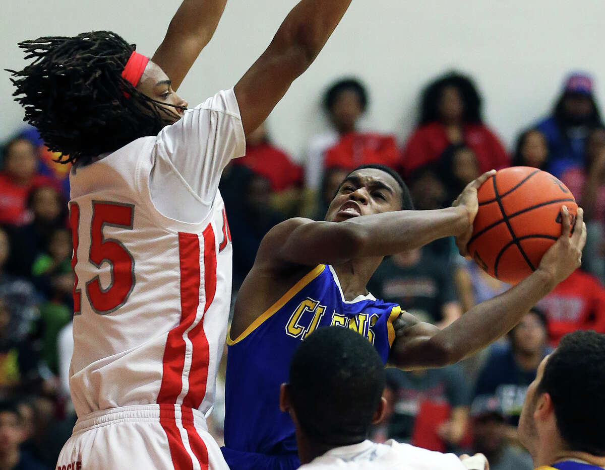 Clemens guard Jalon Gates double pumps a shot under the basket against Judson's Brandon Armstrong in a 26-5A game at Judson High School Tuesday. Clemens used a fourth quarter comeback to beat the Rockets 73-68.