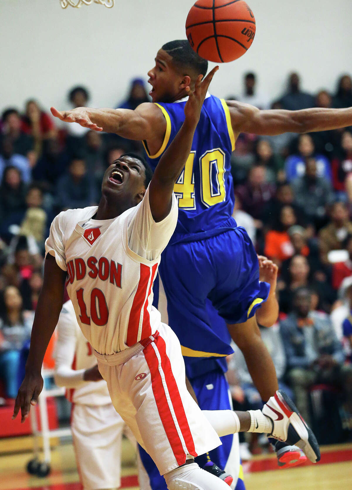Rocket guard Devin Blair stretches away from Frank Harris for a layup in the first half.