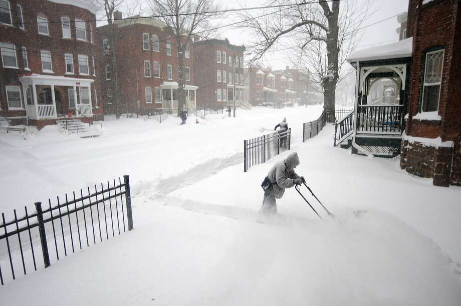 Hartford residents begin to dig out as they confront the snowstorm on Tuesday morning, Jan. 27, 2015 in Putnam Heights, Conn.  Photo: Patrick Raycraft, McClatchy-Tribune News Service
