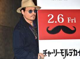 "Johnny Depp attends the photo call for ""Mortdecai"" at The Peninsula Tokyo on January 28, 2015 in Tokyo, Japan."