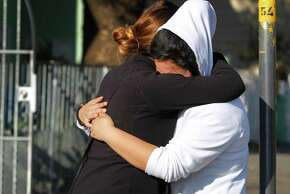 Blanca Soza (left) consoles her niece Brianna Soza, 13, in San Francisco, Calif. on Wednesday, Jan. 28, 2015, who's mother Maria Lourdes Soza died when she was hit by gunshots in a shootout in front of her Bayview district home on Revere Avenue Tuesday afternoon. Blanca is Lourdes' sister.