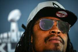 Marshawn Lynch refuses to answer questions from members of the media during Super Bowl XLIX media interviews on Wednesday, January 28, 2015 at the team's hotel in Phoenix, Arizona.