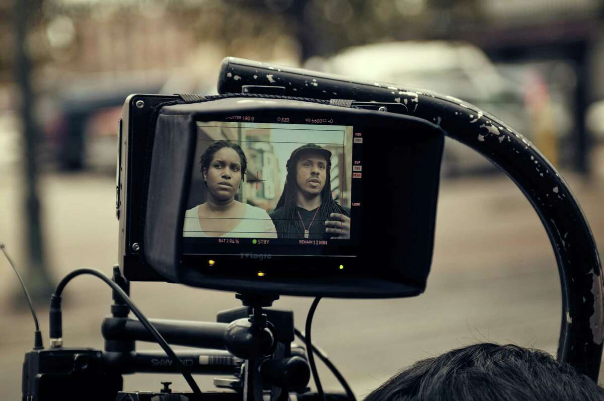 """Filmmaker Ya'Ke Smith with Mikala Gibson, his wife and the film's star, on the set of """"dawn."""""""