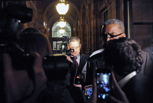 Sheldon Silver,center, leaves the Capitol building following a day of NYS Assembly debate on the Speaker's future on Tuesday Jan. 27, 2015 in Albany, N.Y. (Michael P. Farrell/Times Union) Photo: Michael P. Farrell, Albany Times Union