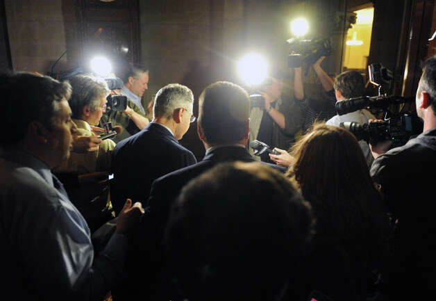 Sheldon Silver, left, leaves the Capitol building surrounded by media following a day of NYS Assembly debate on the Speaker's future on Tuesday Jan. 27, 2015 in Albany, N.Y. (Michael P. Farrell/Times Union) Photo: Michael P. Farrell, Albany Times Union