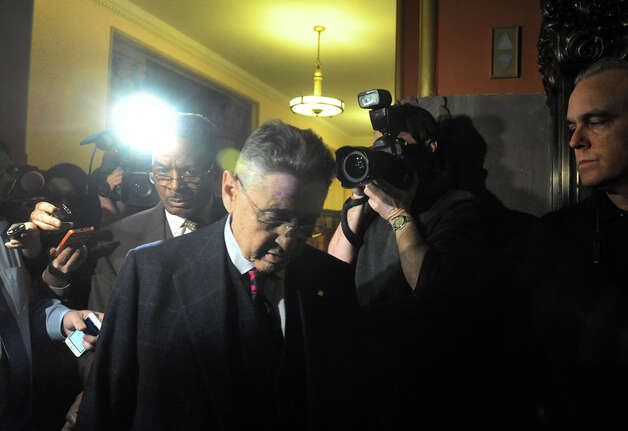 Sheldon Silver, center, leaves the Capitol building following a day of NYS Assembly debate on the Speaker future on Tuesday Jan. 27, 2015 in Albany, N.Y. (Michael P. Farrell/Times Union) Photo: Michael P. Farrell, Albany Times Union