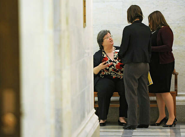 Assembly member Cathy Nolan, left, chats with a couple women while Assembly members are deciding on the fate of Speaker Sheldon Silver Monday, Jan. 26, 2015 in Albany, N.Y. (Lori Van Buren / Times Union) Photo: Lori Van Buren, Albany Times Union