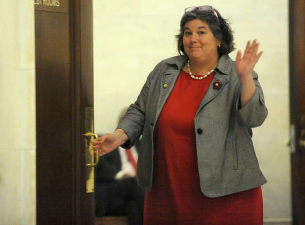 Assembly member Carrie Woerner waves as she opens a door while Assembly members are deciding on the fate of Speaker Sheldon Silver Monday, Jan. 26, 2015 in Albany, N.Y. (Lori Van Buren / Times Union) Photo: Lori Van Buren, Albany Times Union