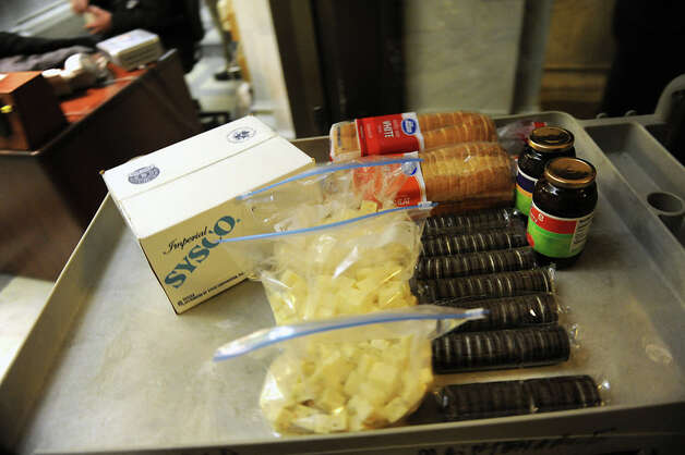 Food is delivered to the lounge area for Assembly members as they decide on the fate of Speaker Sheldon Silver at the Capitol Monday, Jan. 26, 2015 in Albany, N.Y. (Lori Van Buren / Times Union) Photo: Lori Van Buren, Albany Times Union