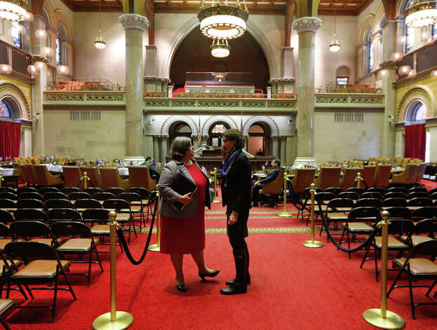 Assemblywoman Carrie Woerner, D-Round Lake, left, and Patricia Fahy, D-Albany, talk in the Assembly Chamber at the Capitol, Tuesday, Jan. 27, 2015, in Albany, N.Y. Democrats in the Assembly debated how to select their next leader, even though longtime Speaker Sheldon Silver has yet to resign after he was charged with taking millions of dollars in kickbacks over a decade. Session was canceled due to weather and the uncertainty of who will be speaker. (AP Photo/Mike Groll) ORG XMIT: NYMG104 Photo: Mike Groll, AP / AP