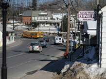Newtown officials are considering adding signs to help direct people to the town's businesses.