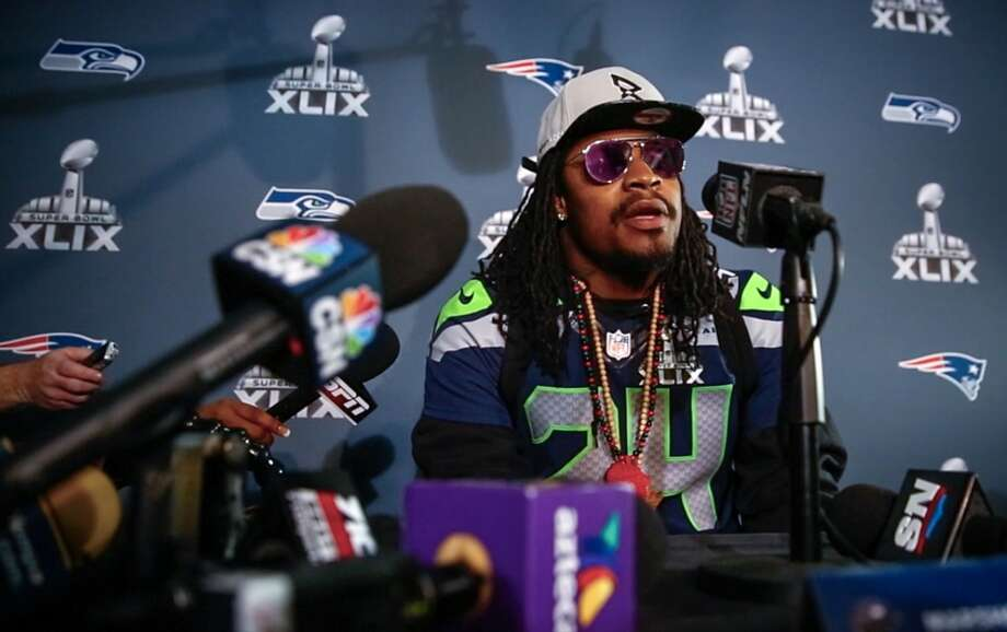 Marshawn Lynch sits at a microphone during Super Bowl XLIX media interviews on Wednesday, January 28, 2015 at the team's hotel in Phoenix, Arizona. Photo: JOSHUA TRUJILLO, SEATTLEPI.COM