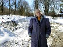 Susan Grisell lives close to the former railroad crossing on Waller Road in New Milford, Conn. Residents near the crossing feel isolated, despite Housatonic Railroad putting in a turnaround point near the crossing closing. Wednesday, January 28, 2015.