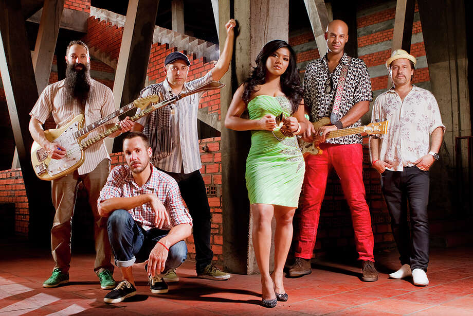 Members of psychedelic Cambodian surf rock band Dengue Fever: Zack Holtzman (left), Paul Smith, Ethan Holtzman, Chham Nimol, Senon Williams and David Ralicke. Photo: Marc Walker / ONLINE_YES