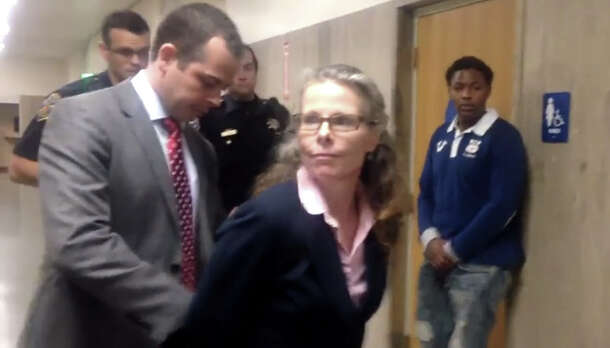 Public Defender Jami Tillotson arrested at the SF Hall of Justice by an undercover police officer on Jan. 27, 2015.
