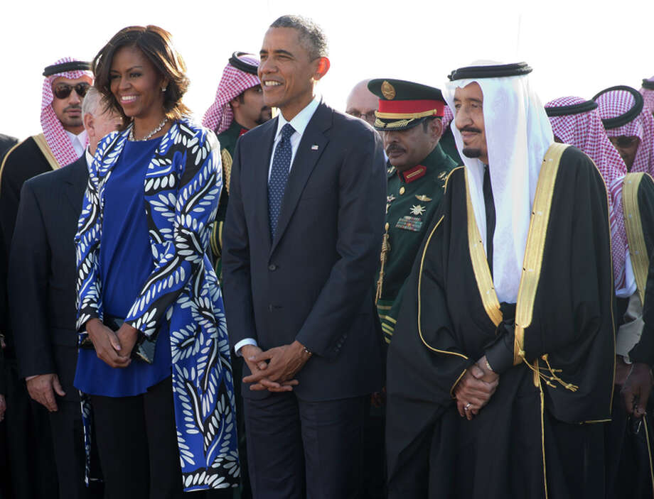 President Obama and first lady Michelle Obama stand with new Saudi king Tuesday. Photo: Carolyn Kaster / Associated Press / AP