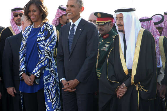 President Obama and first lady Michelle Obama stand with new Saudi king Tuesday.