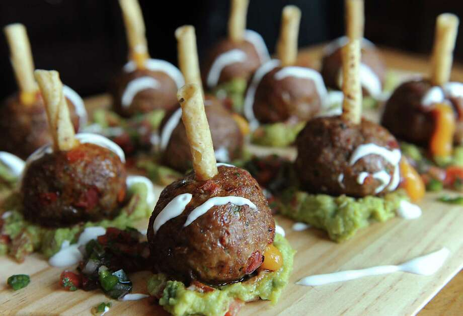 Chef Mike Spain's meatball dish for the Superbowl at Druthers Brewing on Friday, Jan. 23, 2015 in Saratoga Springs, N.Y. (Lori Van Buren / Times Union) Photo: Lori Van Buren / 00030288A