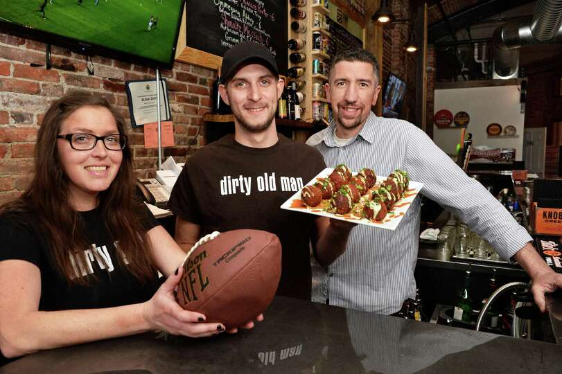 Slidin' Dirty co owners Brooke, left, and Tim Taney, right, with chef Shawn Work and his new take on