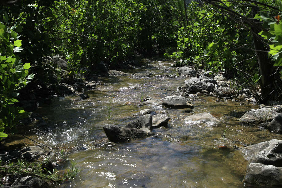 In this 2012 file photo, a tributary to Blanco creek flows through foliage on a ranch near Sabinal that has become part of the Edwards Aquifer Protection Program. Photo: JOHN DAVENPORT /SAN ANTONIO EXPRESS-NEWS / SAN ANTONIO EXPRESS-NEWS (Photo can be sold to the public)