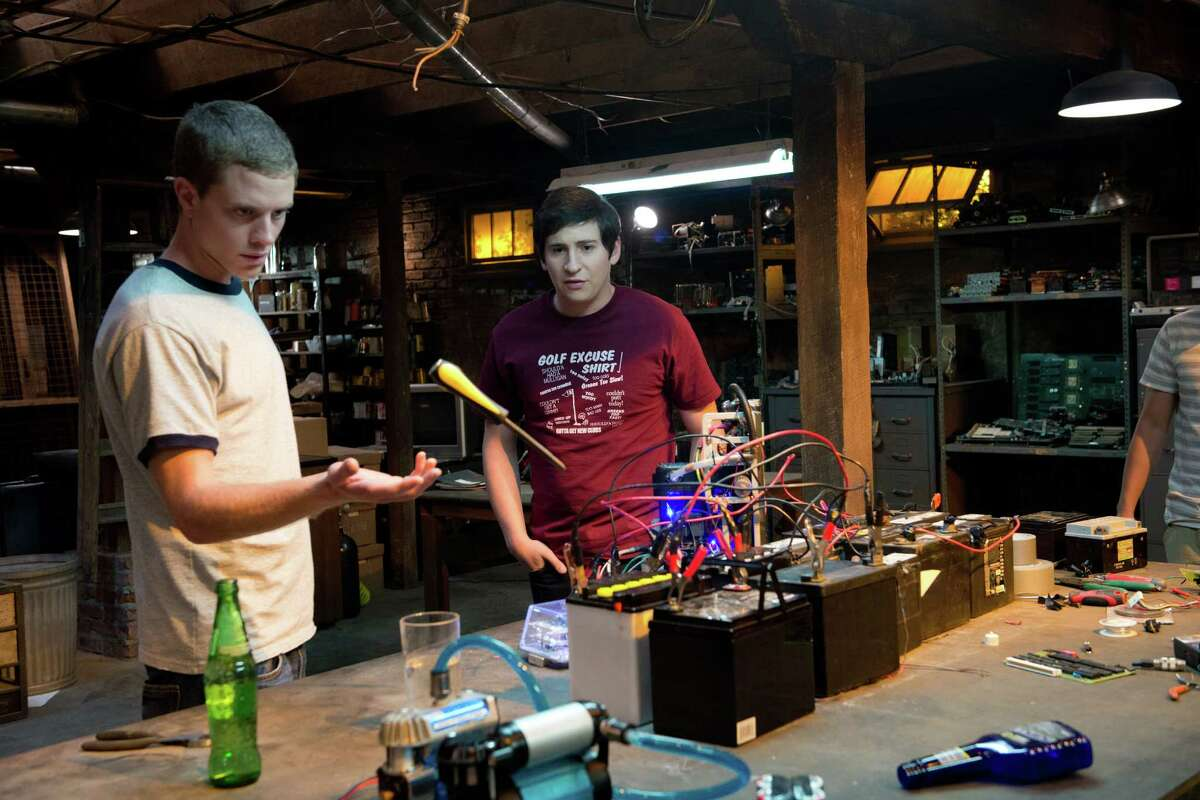 David (Jonny Weston, left,) and Quinn (Sam Lerner) work on a time-travel device using plans from David's late father in the science fiction thriller