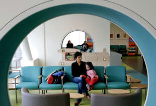 The pediatric waiting room, left, at the Gateway Medical Building is part of the $1.52 billion UCSF Medical Center, opening in Mission Bay on Sunday.