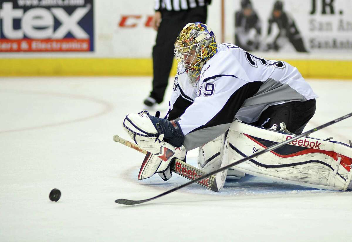 Rampage goaltender Dan Ellis makes a save in the third period of an AHL game against the Texas Stars on Nov. 23, 2014, at the AT&T Center. San Antonio won 3-0.