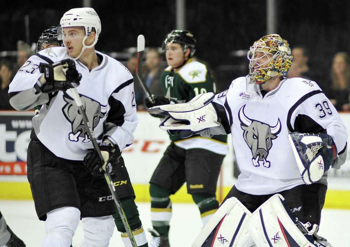 Rampage left wing Connor Brickley and goaltender Dan Ellis watch play in the third period against the Texas Stars.