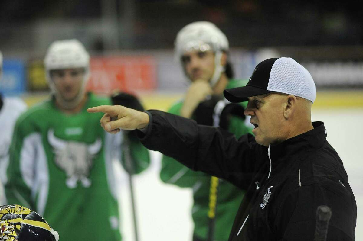 Rampage head coach Tom Rowe speaks with his team during preseason camp on Oct. 7, 2014.