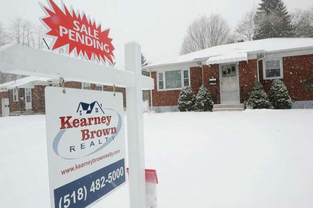 For sale sign in front of a home on Hillcrest Ave. on Tuesday, Jan. 27, 2015 in Albany, N.Y. (Lori Van Buren / Times Union) Photo: Lori Van Buren