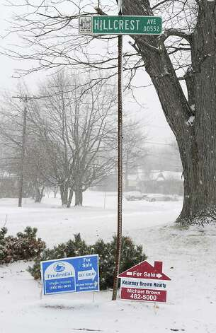 For sale signs are seen at the bottom of the street sign for Hillcrest Ave. on Tuesday, Jan. 27, 2015 in Albany, N.Y. (Lori Van Buren / Times Union) Photo: Lori Van Buren