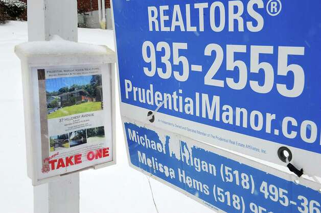 Real Estate literature is seen on a for sale sign in front of 37 Hillcrest Ave. on Tuesday, Jan. 27, 2015 in Albany, N.Y. (Lori Van Buren / Times Union) Photo: Lori Van Buren