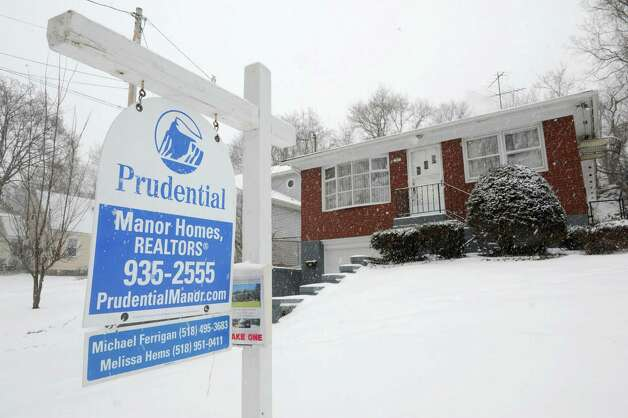For sale sign in front of 37 Hillcrest Ave. on Tuesday, Jan. 27, 2015 in Albany, N.Y. (Lori Van Buren / Times Union) Photo: Lori Van Buren