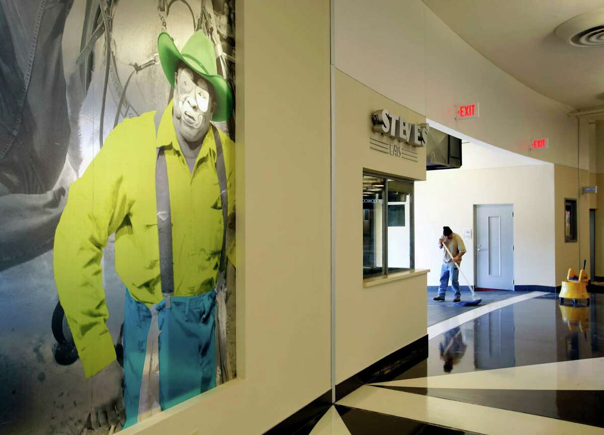 A colorized picture of famous rodeo clown Leon Coffey is included in the new artwork, seen Tuesday, Jan. 28, 2015, that adorns the concourse of the recently renovated Freeman Coliseum.